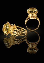 Gold ring with brilliants and gem on a black