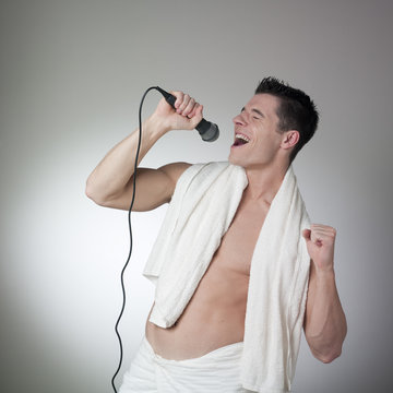 bare-chest athlete singing