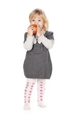 Baby girl eating apple