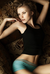 beautiful girl lying in bed at home