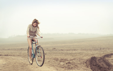 beautiful girl rides a bicycle