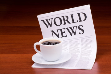 The newspaper LATEST NEWS.with the headline WORLD NEWS