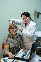 ophthalmologist  and patient testing  eyesight