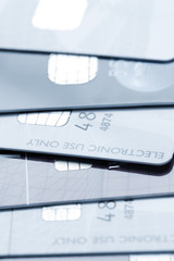 Stack of credit cards toned blue