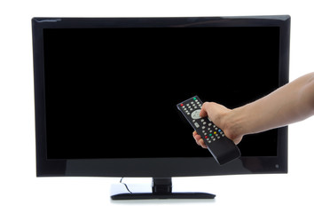 Hand with remote control turning on led tv