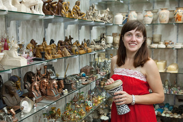tourist  chooses souvenir  in egyptian shop
