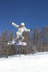 Flying snowboarder
