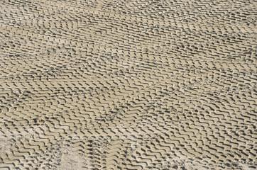 Tires prints on sandy ground