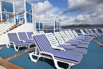 Roe of deck chairs on sundeck of the cruise ship