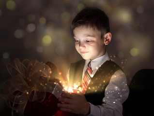 Child opening a magic gift box