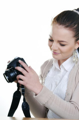 Smiling girl with a camera