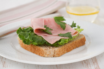 toast with lettuce, ham and parsley
