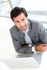 Portrait of confident businessman in meeting