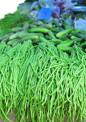 Green beans and cucumbers on market