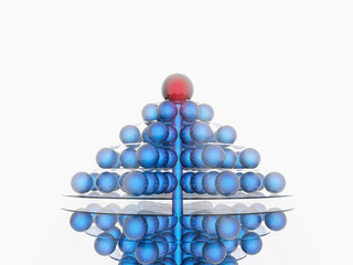 Pyramid of blue balls with red on the top on a white background
