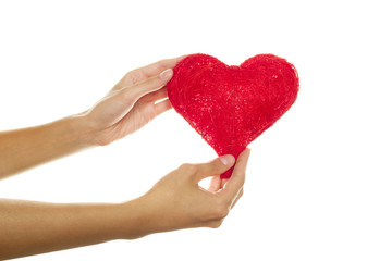Female hands holding a red heart