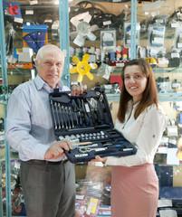 mature man buys  automotive  tool set