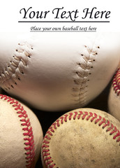 Three baseballs and softball with white copy space.