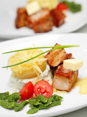 Tasty meal with pork, potato and vegetables