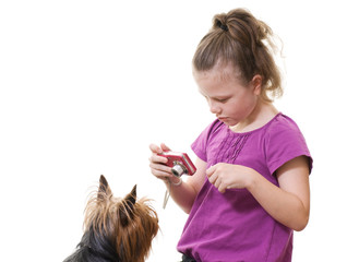 preteen girl taking photo of pet dog