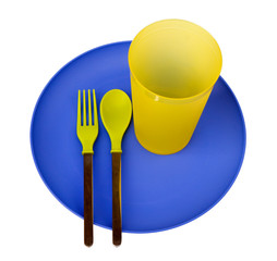 Plastic plate, cup, spoon and fork, isolated on white backgr