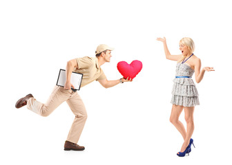 Delivery boy in a rush delivering red heart shaped object and ex