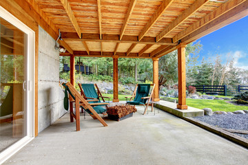 Ground level deck with chairs and door.