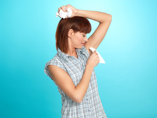 attractive young woman wiping her armpit sweat