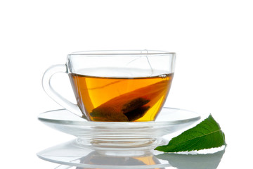 Cup of tea and mint isolated on white background