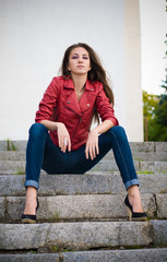 Young fashion girl sitting on stairs