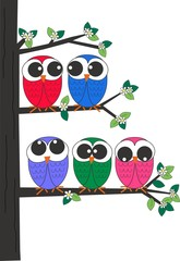 a group of owls sitting in a tree