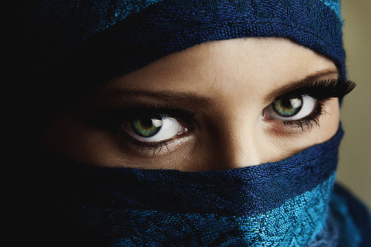 Young arabian woman in hijab with sexy blue eyes