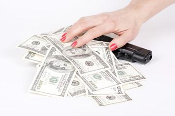 hundred-dollar bills on the gun with hand