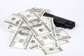 hundred-dollar bills on the gun