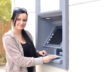 Fototapeta femme avec ATM