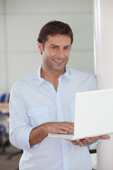 Man with laptop in hand