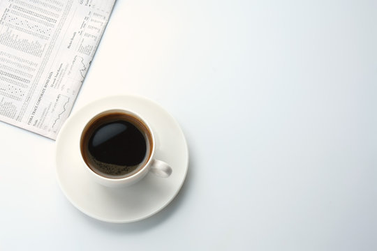 Coffee over newspaper