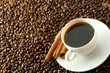 Cup with coffee and cinnamon