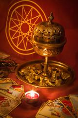 Tarot cards illuminated by candlelight.