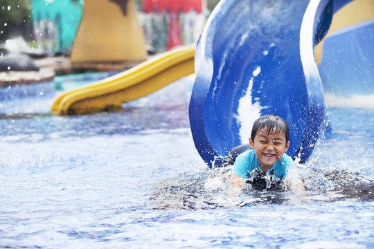 Asian boy having fun at swimming pool