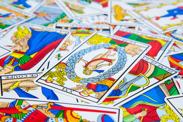 Mixed tarot cards on the table (1).