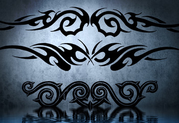 Black tribal armband with water reflection. Tattoo design over b