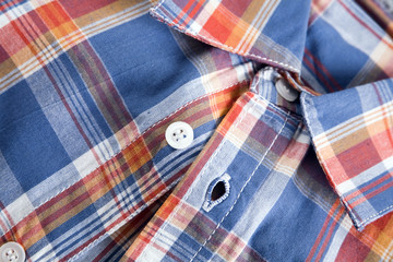 bright multi-colored plaid shirt with a collar