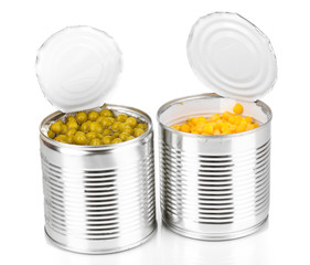 Open tin cans of corn and peas isolated on white