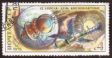 USSR - CIRCA 1976: A post stamp divided to  Day of Cosmonautics