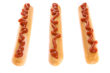Three sausages with ketchup