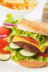 Classic hamburger with cheese, tomato and lettuce