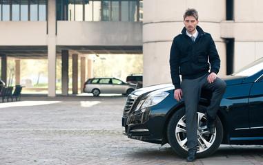 Young elegant man portrait with luxury car.