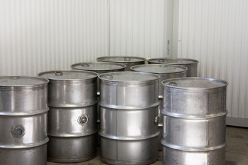 Industrial steel drums in a warehouse