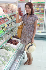 a young woman chooses foods in the store........